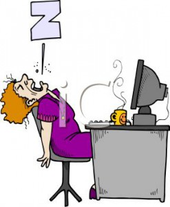 0511-1107-2914-1722_Tired_worker_asleep_on_the_job_in_front_of_the_computer_clipart_image